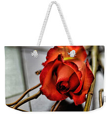 Weekender Tote Bag featuring the photograph A Rose On Bamboo by Diana Mary Sharpton