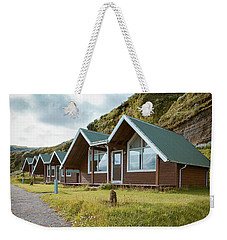 Weekender Tote Bag featuring the photograph A Row Of Cabins In Iceland by Edward Fielding
