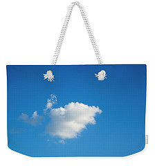 Weekender Tote Bag featuring the photograph A Single Cloud by Eric Christopher Jackson