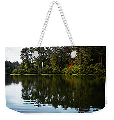 Weekender Tote Bag featuring the photograph A Single Red Tree by Parker Cunningham