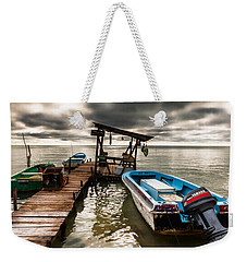 Weekender Tote Bag featuring the photograph A Storm Brewing by Lawrence Burry