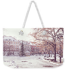 Weekender Tote Bag featuring the photograph A Street In Warsaw, Poland On A Snowy Day by Juli Scalzi