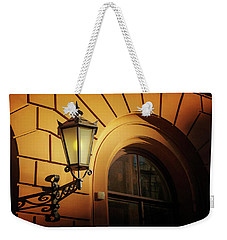 Weekender Tote Bag featuring the photograph A Street Lamp In Lisbon Portugal  by Carol Japp