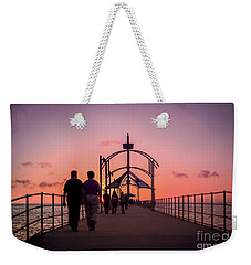 Weekender Tote Bag featuring the photograph A Stroll Along Sunset Pier by Ray Warren
