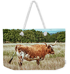 Weekender Tote Bag featuring the photograph A Texas Legend by Linda Unger