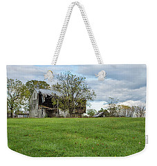 Weekender Tote Bag featuring the photograph A Tired Old Barn by John M Bailey