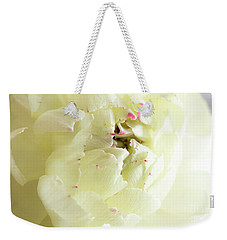 Weekender Tote Bag featuring the photograph A Touch Of Pink by Wendy Wilton