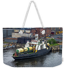 Weekender Tote Bag featuring the photograph A Train Ferry In St Petersburg Carrying Freight by Clare Bambers