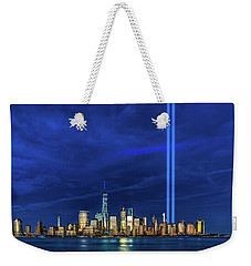 Weekender Tote Bag featuring the photograph A Tribute At Dusk by Chris Lord