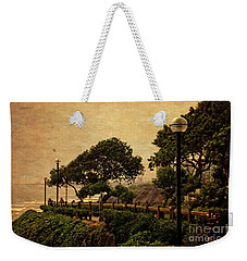 Weekender Tote Bag featuring the photograph A Walk On The Edge - Peru by Mary Machare