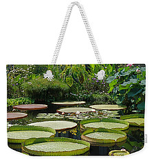Weekender Tote Bag featuring the photograph A Water Garden by Byron Varvarigos