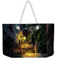 Weekender Tote Bag featuring the photograph A Wet Evening In Marburg by David Morefield