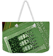 Weekender Tote Bag featuring the photograph A Woman's Hardy Garden by Rebecca Sherman