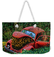 Weekender Tote Bag featuring the photograph Abandon by Paul Wear
