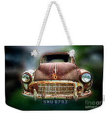 Weekender Tote Bag featuring the photograph Abandoned Car by Charuhas Images