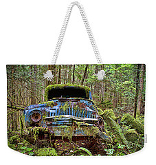 Weekender Tote Bag featuring the photograph Abandoned Car In The Forest by Peggy Collins