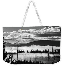 Weekender Tote Bag featuring the photograph Rising Above by Colleen Coccia