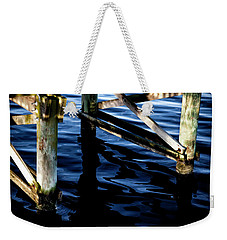 Weekender Tote Bag featuring the photograph Above Water by Eric Christopher Jackson