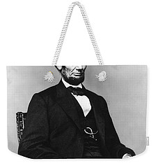 Weekender Tote Bag featuring the photograph Abraham Lincoln Portrait - Used For The Five Dollar Bill - C 1864 by International  Images