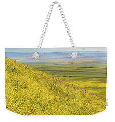 Weekender Tote Bag featuring the photograph Across The Plain by Marc Crumpler