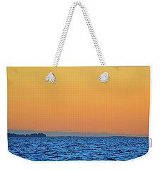 Weekender Tote Bag featuring the photograph Across The Water  by Lyle Crump