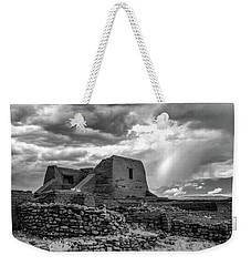 Weekender Tote Bag featuring the photograph Adobe, Stones, And Rain by James Barber