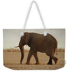 Weekender Tote Bag featuring the digital art African Elephant Walk by Ernie Echols