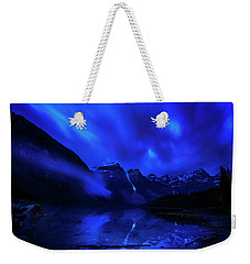 Weekender Tote Bag featuring the photograph After Midnight by John Poon