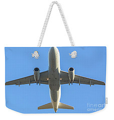 Airplane Isolated In The Sky Weekender Tote Bag