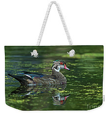 Weekender Tote Bag featuring the photograph Aix Sponsa.. by Nina Stavlund