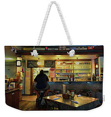 Weekender Tote Bag featuring the photograph All By Myself by John Rivera