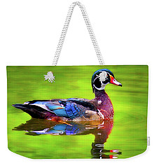 Weekender Tote Bag featuring the photograph Almost Perfect Wood Duck by Jean Noren