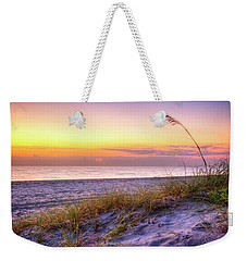 Weekender Tote Bag featuring the photograph Alone At Dawn by Debra and Dave Vanderlaan