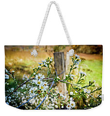 Weekender Tote Bag featuring the photograph Along A Fence Row by Douglas Stucky