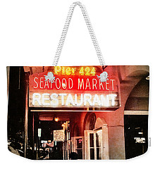 Weekender Tote Bag featuring the photograph Along Bourbon Street - New Orleans by Glenn McCarthy Art and Photography
