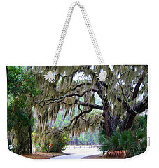 Weekender Tote Bag featuring the photograph Along The Path by Kathryn Meyer