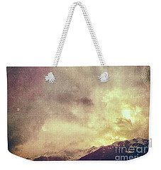 Weekender Tote Bag featuring the photograph Alps With Dramatic Sky by Silvia Ganora