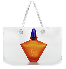 Weekender Tote Bag featuring the photograph Amber Perfume Bottle by David and Carol Kelly