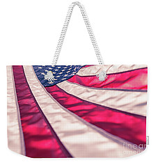 Weekender Tote Bag featuring the photograph American Flag In Red White Stripe,stars And Blue Symbolic Of Pat by Jingjits Photography