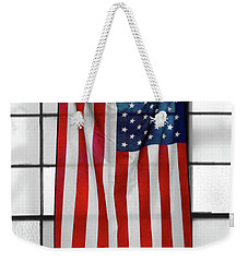Weekender Tote Bag featuring the photograph American Flag In The Window by Mike McGlothlen
