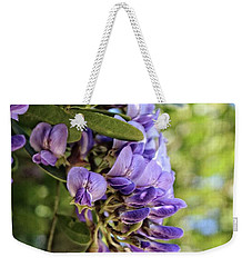 Weekender Tote Bag featuring the photograph Amethyst Shower by Ella Kaye Dickey