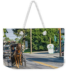 Weekender Tote Bag featuring the photograph Amish Girl On The Road by Patricia Hofmeester