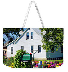 Weekender Tote Bag featuring the photograph Amish House With Mums by Cricket Hackmann