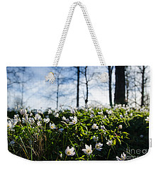 Weekender Tote Bag featuring the photograph Among Windflowers On The Ground by Kennerth and Birgitta Kullman