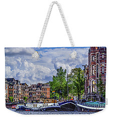 Weekender Tote Bag featuring the photograph Amsterdam 1931 by Janis Knight