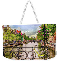 Weekender Tote Bag featuring the photograph Amsterdam Bicycles by Janis Knight