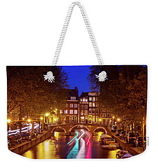 Weekender Tote Bag featuring the photograph Amsterdam By Night by Barry O Carroll