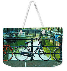 Weekender Tote Bag featuring the photograph Amsterdam Scene by Allen Beatty