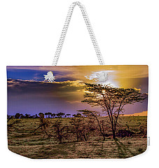 Weekender Tote Bag featuring the photograph An African Sunset by Janis Knight