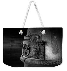 Weekender Tote Bag featuring the photograph An Antique Stove by Doug Camara